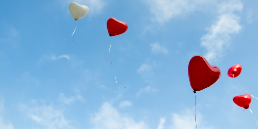 red and white heart balloons - Photo by Christopher Beloch on Unsplash
