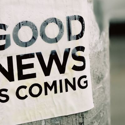 White Good News Is Coming paper on wall photo – Photo by Jon Tyson on Unsplash